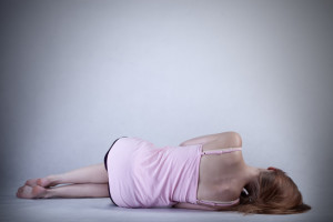 Skinny girl lying on the floor